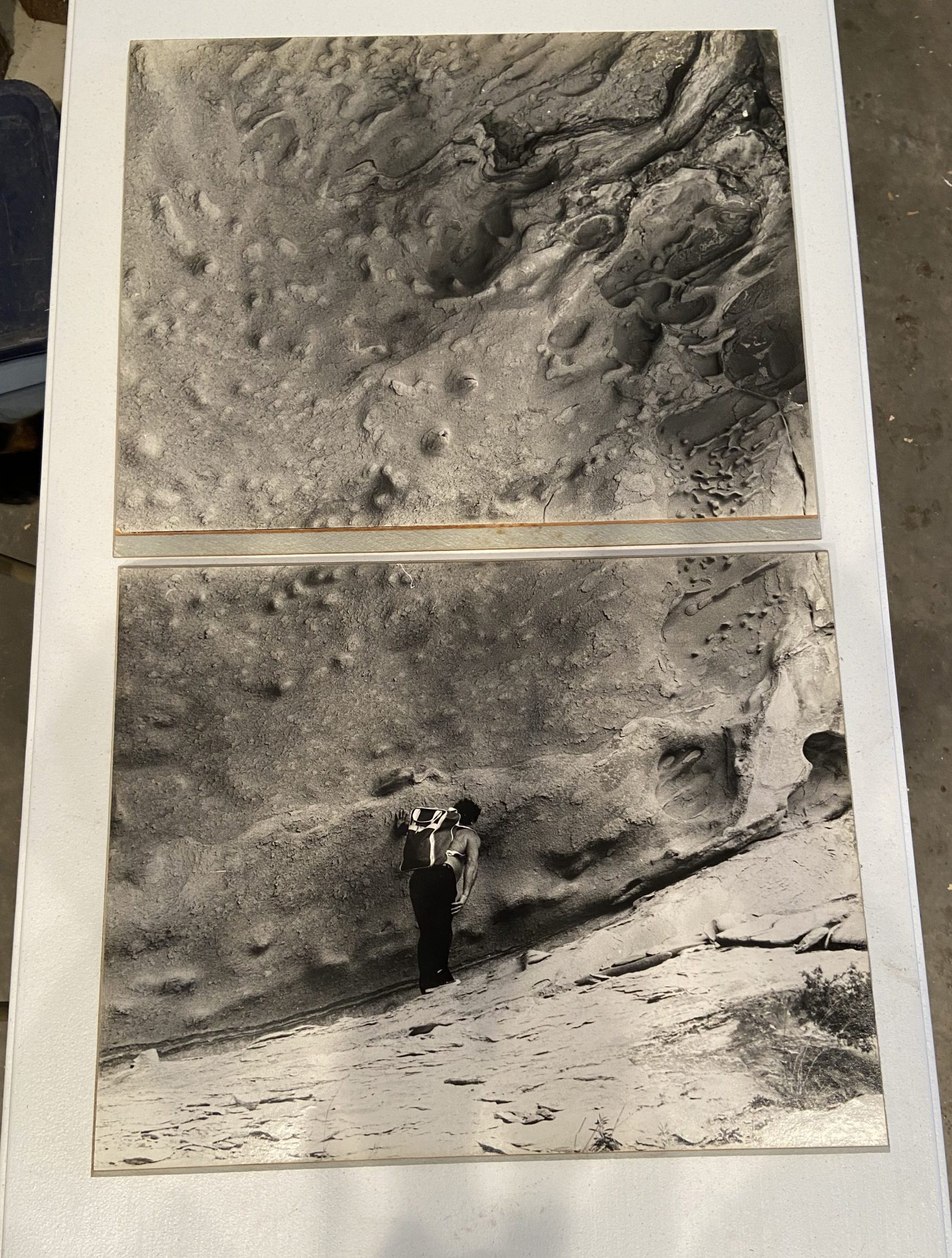 Photgraphs of cave walls, and a figure looking at them