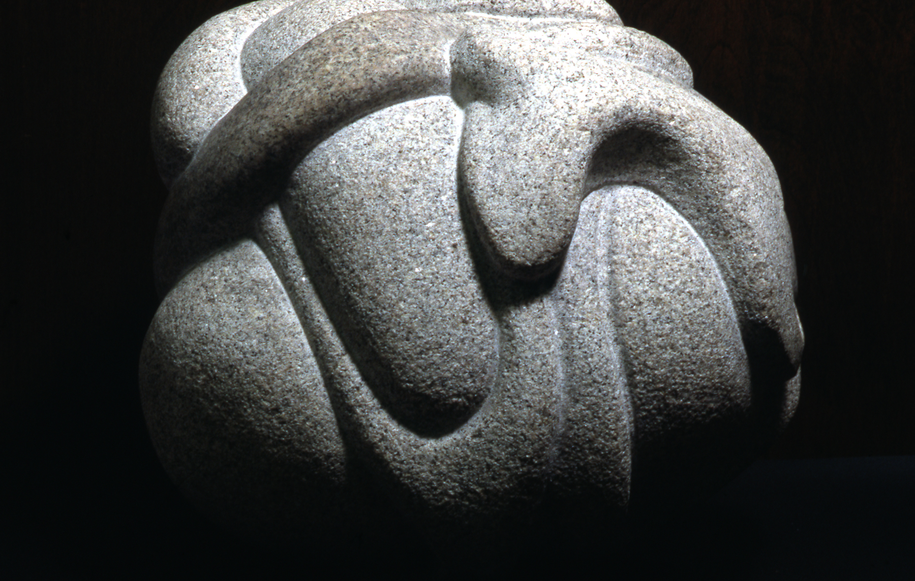 Gray stone carved in graceful stretching forms