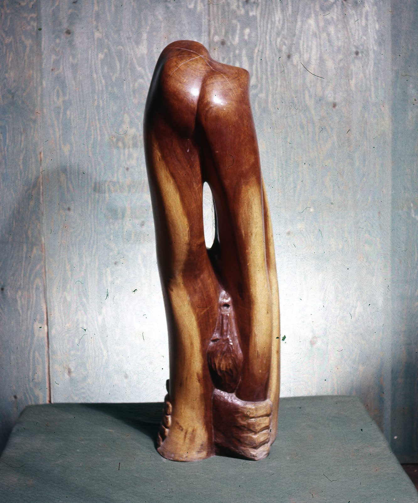 A smooth carved wooden figure