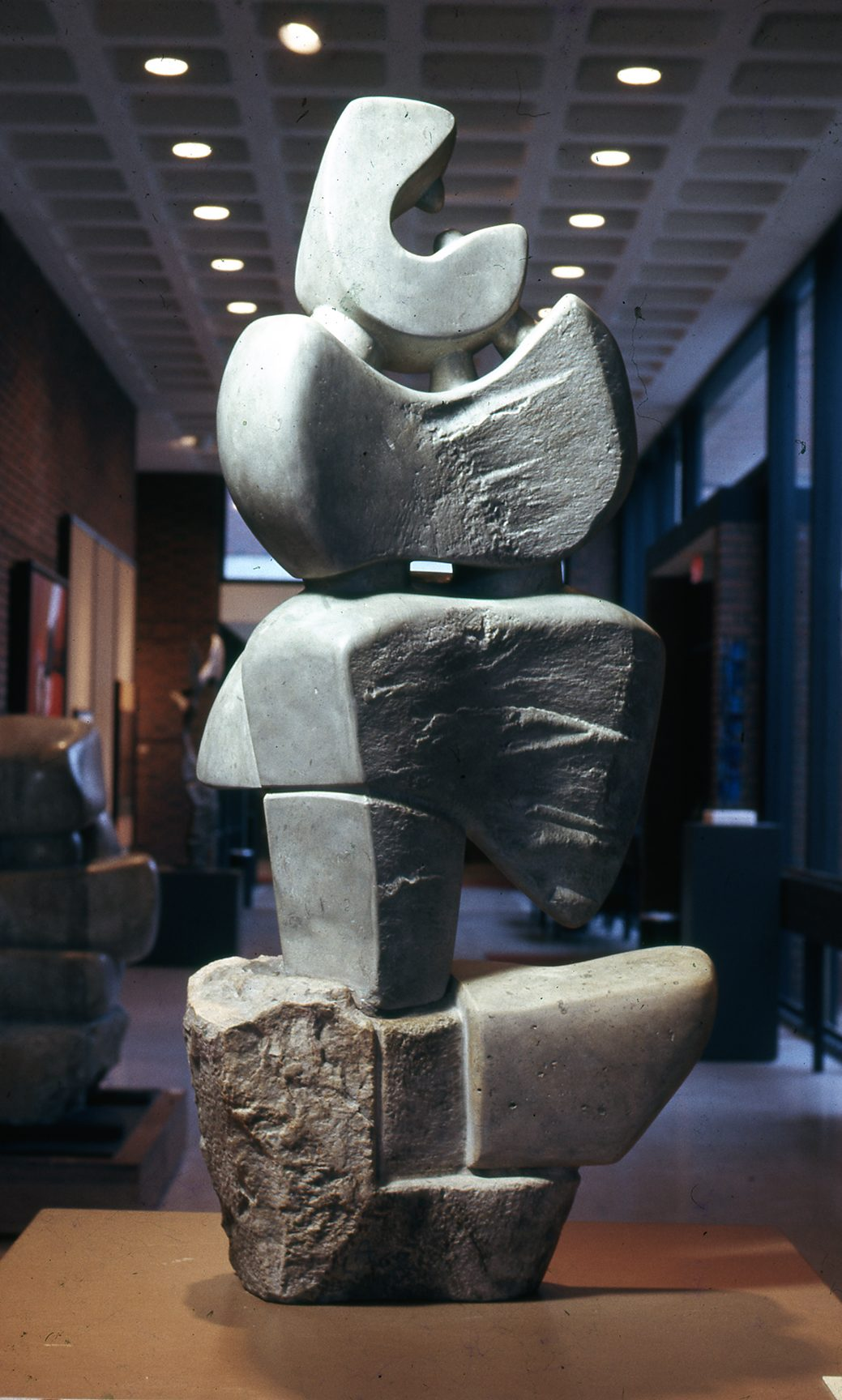 A smooth gray stone carved to look like stacked abstract shapes