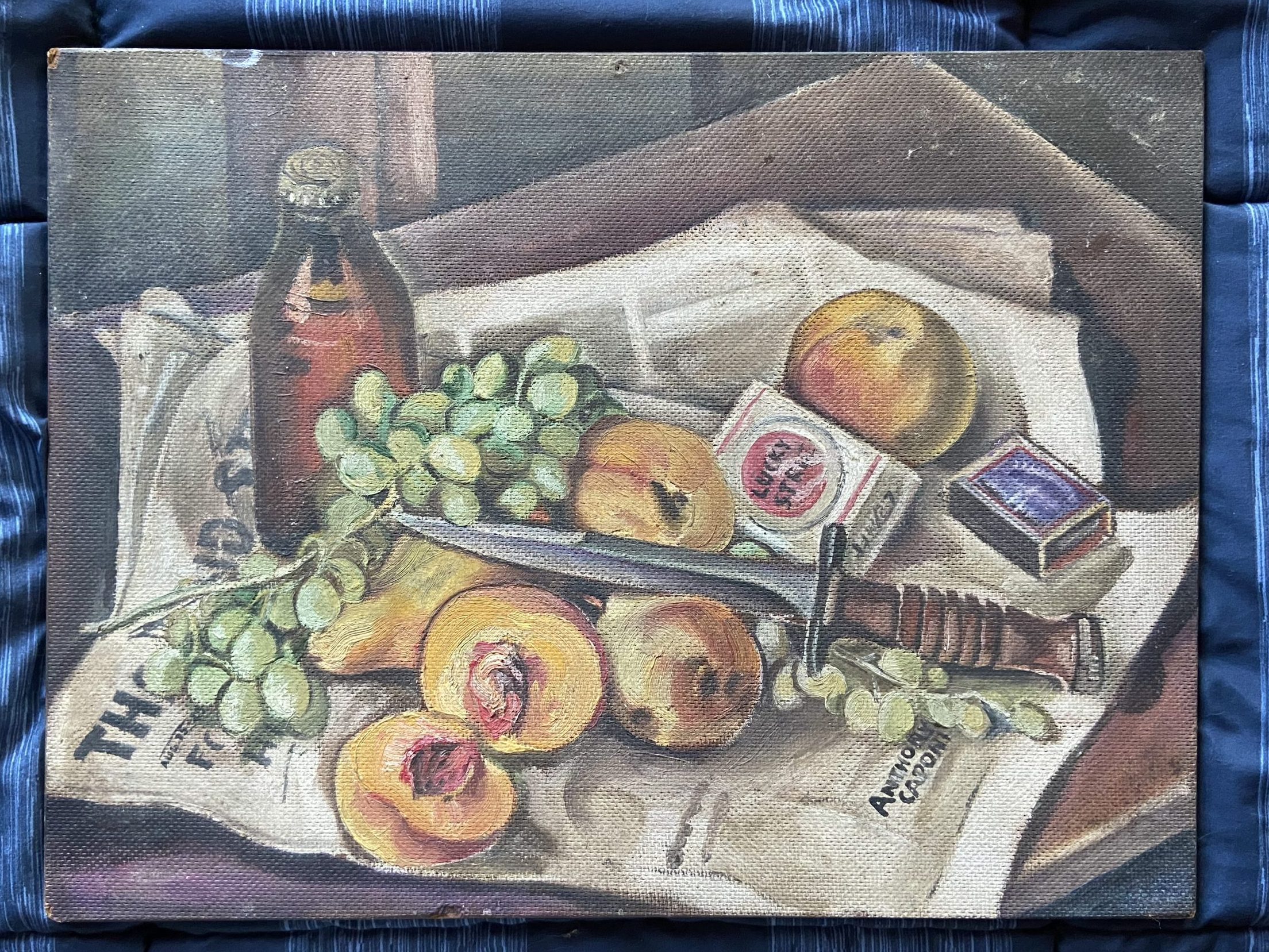 A painting of fruit, cigarettes, drink and a bayonet laying on a newspaper
